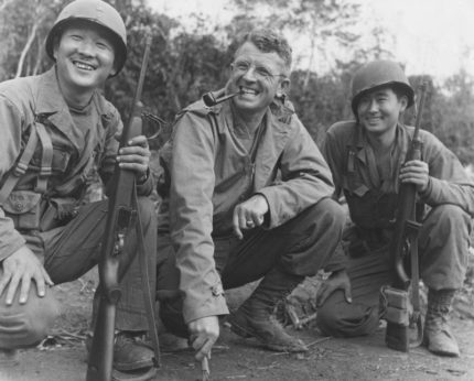 Brig General Frank Merrill poses between two Japanese American interpreters@2x